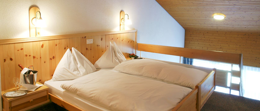 Hotel Sunstar Alpine, Wengen, Bernese Oberland, Switzerland - duplex double bedroom.jpg
